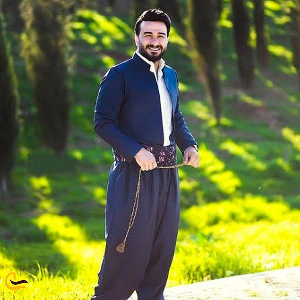 تصویری از مردی با لباس محلی کردی